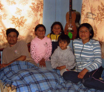 Ana (center) and her family