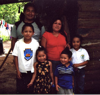Lesly (center) with her family