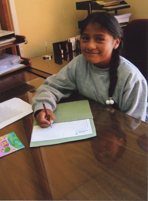 Ana writing a letter to Stefanie at Children International's Center