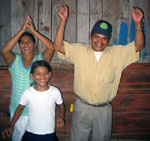 Members of the Rojas Family after learning they were getting a new house thanks to Aura's House donors. (2005)