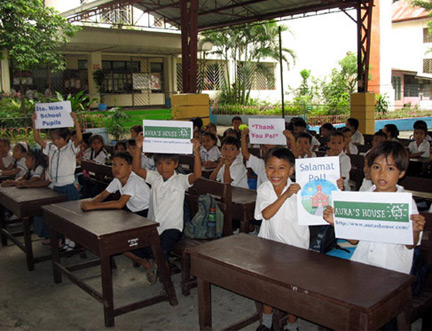 Children for the Sto. Nino Elementary School in Manila thanking Aura's House donors for raising funds for a new classroom.