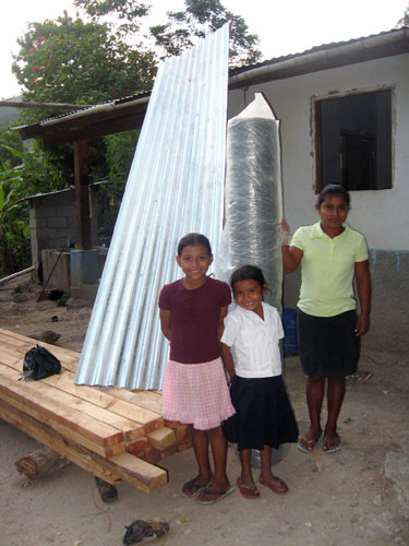 Zoila and siblings with chicken coop materials