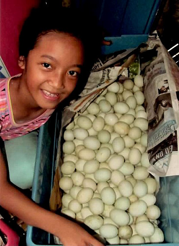 Marfel (8) with eggs for her family's business