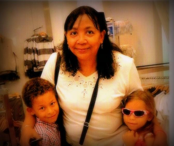 Sharon C. with two of her many sponsored children