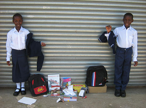 Judy and Christopher with Their School Supplies